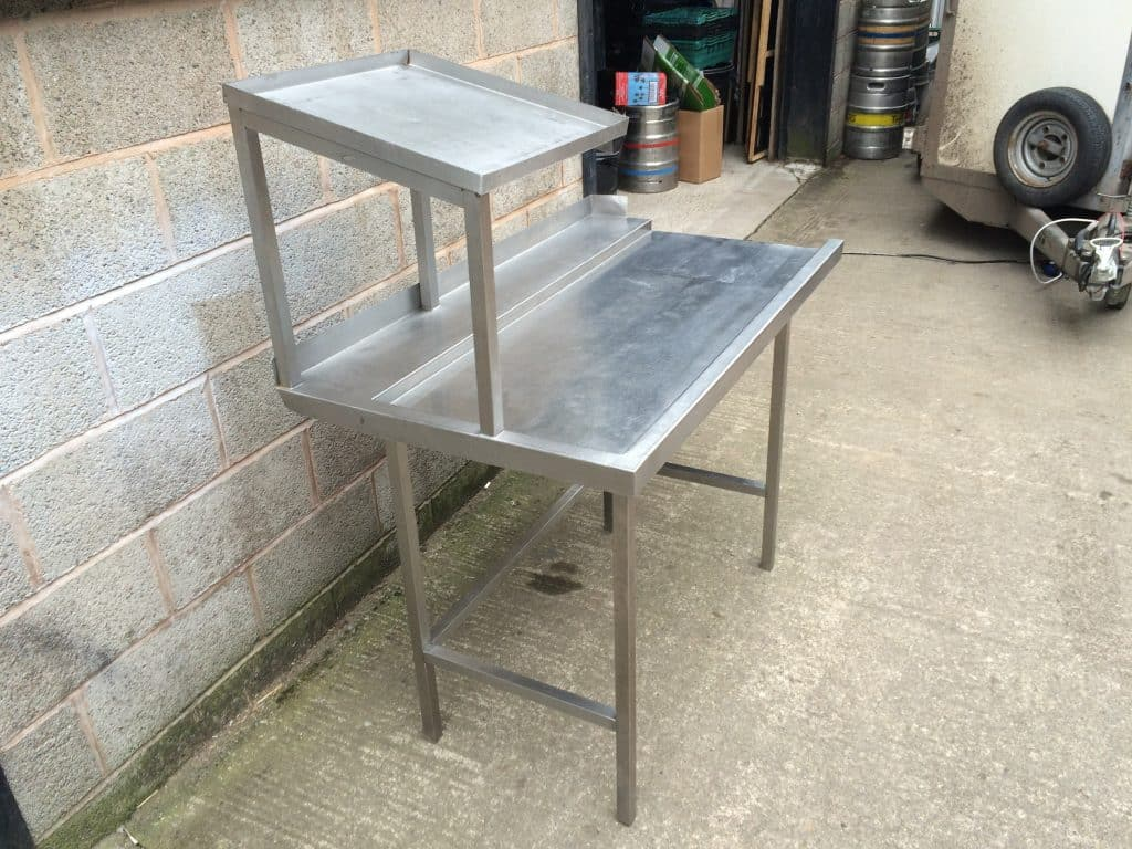 pass through table with tray holder